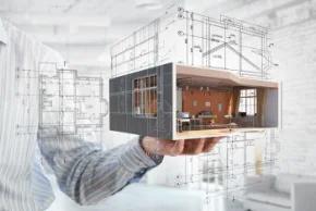 Persona sosteniendo en la mano parte de un edificio modelado con objetos y materiales BIM.